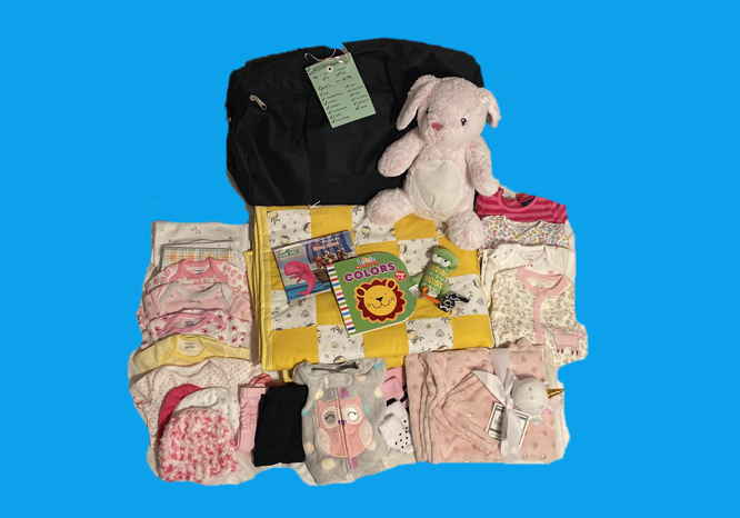 <b><h5>Blue Bag Program supplies blue bags<br> for the children containing basic necessities.</b></h5>